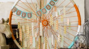 Transform an old bike wheel with spray paint, yarn, and custom-made tags. You can…
