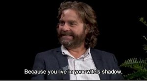 funny caption zach galifianakis interview brad pitt wife's shadow spits gum at him