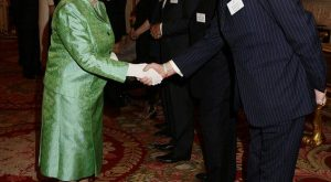 Queen Elizabeth greeted Major General Jamie Balfour, Director General of the Winston Churc...