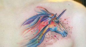 Watercolor unicorn chest tattoo