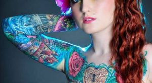 Marvelous Arm Tattoo Of Animated House And Heart Lock For Cool Women0