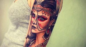 Native American woman upper arm tattoo
