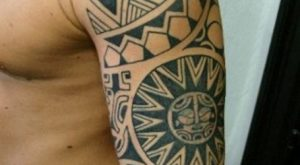 maori and polynesian tattoos on left sleeve