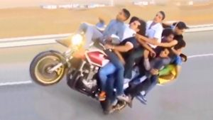 IMAGINE THIS 10 PEOPLE Doing The Motorcycle Wheelie TOTALLY CRAZY